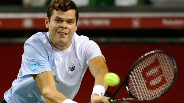 Milos Raonic of Canada returns a shot against Lukas Lacko of Slovakia during their quarter-final match at the Japan Open on Thursday.