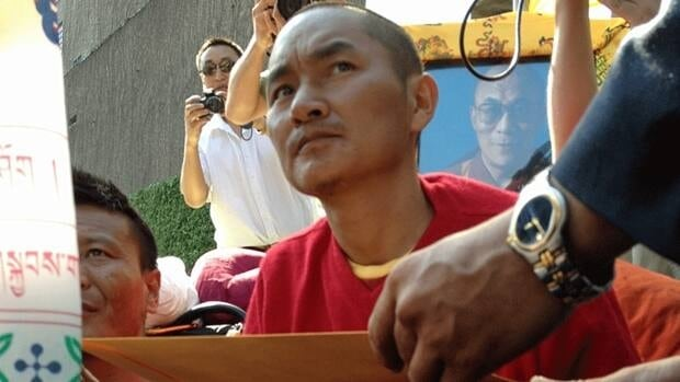 Tenzin Choeki Gyalsen, one of three Tibetans who have been holding a hunger strike outside UN headquarters in New York for the past month, is handed an envelope with a statement saying the UN will look into the protesters' concerns regarding China's repressive rule over Tibet. Gyalsen and his fellow hunger strikers agreed to end their protest March 22 after the UN sent a representative to meet with them.
