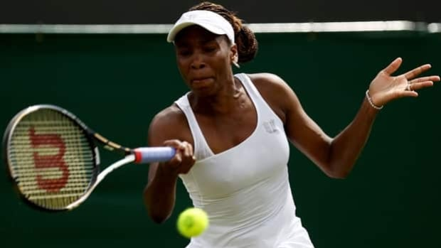 Venus Williams hits a forehand return in Monday's 6-1, 6-3 loss to Elena Vesnina at Wimbledon.