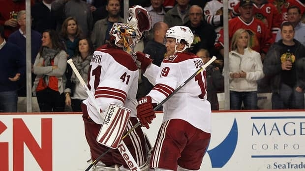 Mike Smith of the Phoenix Coyotes and teammate Shane Doan are together again in Phoenix for a weeklong minicamp with many other NHL stars, including Sidney Crosby.