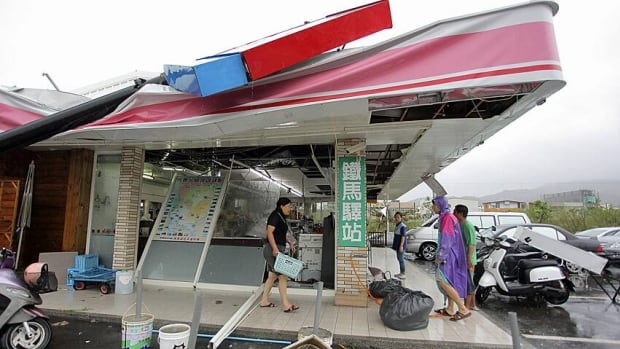 A shop in Pingtung County, in southern Taiwan, falls over in winds brought by Typhoon Tembin last week