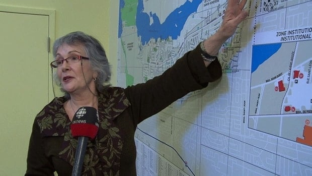 Pierrefonds-Roxboro councillor Catherine Clément-Talbot shows on a map where the car-sharing service will be available.