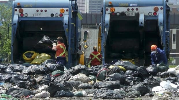 City workers clear garbage from a temporary dump in downtown Toronto after a 39-day civic strike in 2009. Another strike could happen as soon as early February.