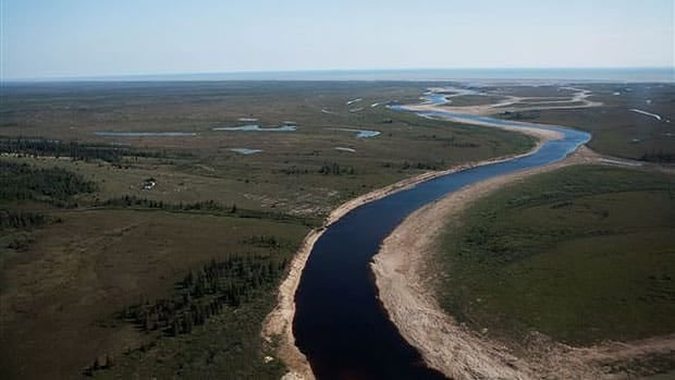 Aerial view of the Owl River with Hudson Bay in the distance.