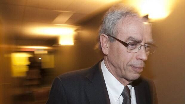 Natural Resources Minister Joe Oliver leaves a news conference in Gatineau, Que.