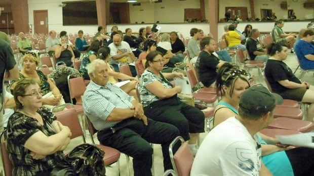 Thunder Bay flood victims attend information meeting held by a local law firm at Slovak Legion.
