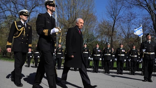 Isaeli President Shimon Peres arrives at Rideau Hall Monday, accompanied by a military honour guard. His first official tour of Canada runs through Thursday, featuring events in Ottawa, Toronto and Montreal.