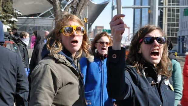 Anti-racism counter-protesters yell at a group of white pride advocates Saturday afternoon in Edmonton.