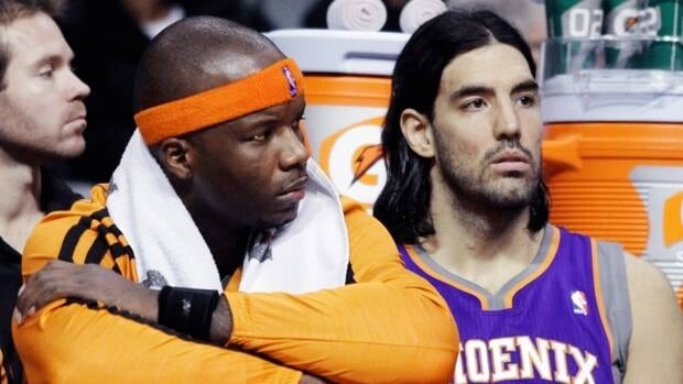 Phoenix Suns centre Jermaine O'Neal, left, and forward Luis Scola, right, sit on the bench in the final two minutes of their 117-77 loss to the Detroit Pistons on Wednesday, Nov. 28, 2012, in Auburn Hills, Mich.