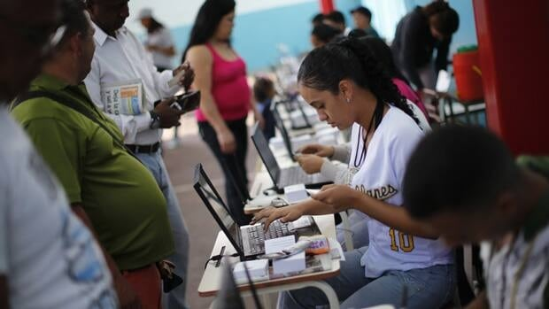 Venezuelans line up to cast their votes Sunday during a governors election in Caracas. Chavez's movement won 20 of 23 states, according to results announced by electoral council.
