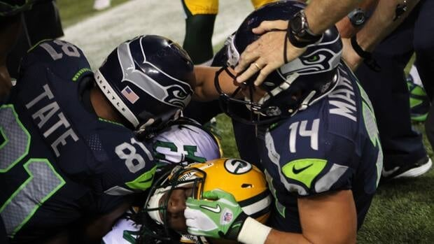 Wide receiver Golden Tate of the Seattle Seahawks, left, wrestles with cornerback M.D. Jennings of the Green Bay Packers on the controversial final offensive play of Monday's game.