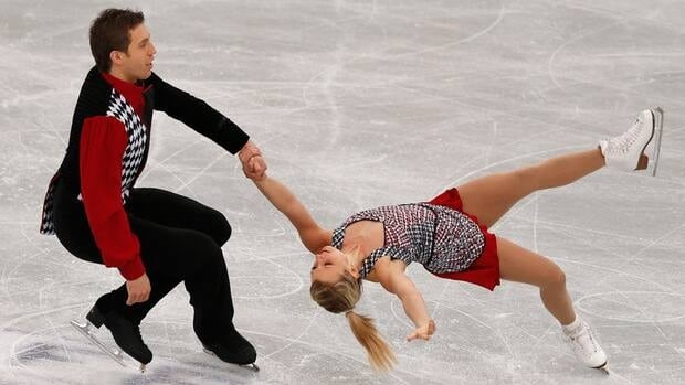 Kirsten Moore-Towers, left, and Dylan Moscovitch are nipping at the heels of the Russian pair in first place after the short program at the NHK Trophy in Japan. The Canadian duo sit .47 points behind the leaders Vera Bazarova and Yuri Larionov.