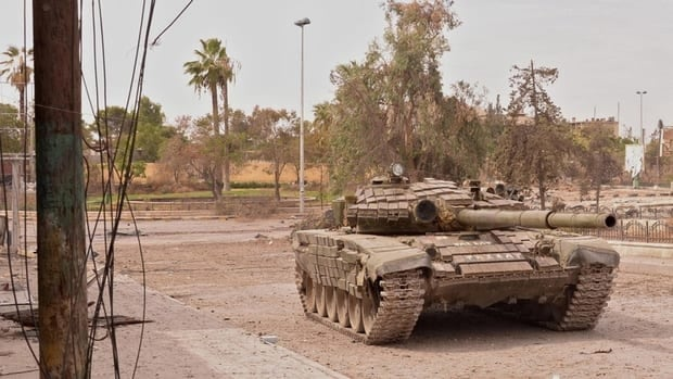 A Syrian army tank is seen in the Khan al-Raslan neighbourhood of Syria's northern city of Aleppo on Oct 8, 2012. Western countries are mulling their possible actions in the event that Syria should deploy chemical weapons against rebel fighters.