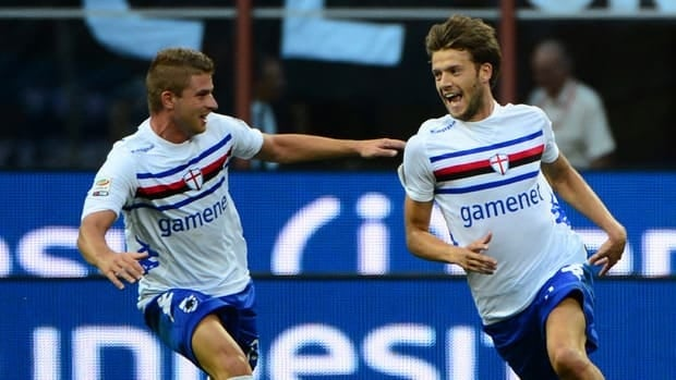 Sampdoria's Andrea Costa, right, celebrates after scoring against the AC Milan on August 26, 2012.