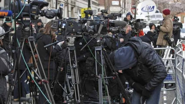 Media gather Tuesday outside the King Edward VII Hospital in central London where Kate, the Duchess of Cambridge, has been admitted with a severe form of morning sickness.