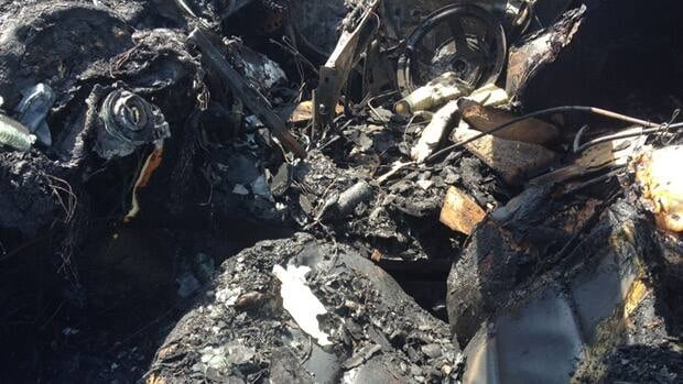 The burned-out interior of the BMW in Sunday's crash on Highway 401. The driver was declared dead at the scene.