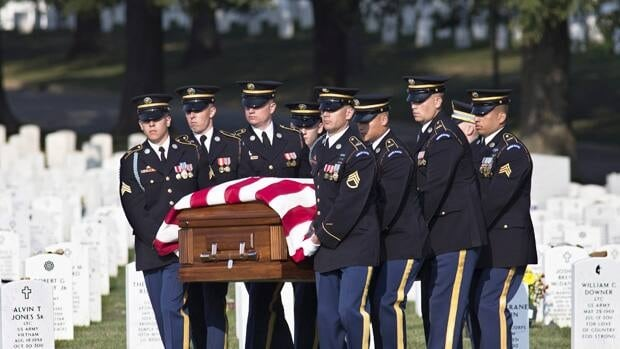 A graveside ceremony for Army Chief Warrant Officer 2 Thalia S. Ramirez, 28, of San Antonio, Texas, is held at Arlington National Cemetery in Arlington, Va. on Wednesday, Sept. 26, 2012.