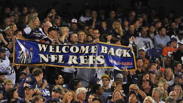 Baltimore Ravens fans cheer to the return of the regular referees during the game against the Cleveland Browns on Thursday night.