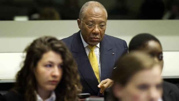 Former Liberian president Charles Taylor waits for the start of his sentencing judgment in the courtroom of the Special Court for Sierra Leone in Leidschendam, near The Hague, Netherlands, on May 30. The SCSL found Taylor guilty on 11 charges of aiding and abetting rebels who went on a bloody rampage during the decade-long war that ended in 2002 with more than 50,000 dead. Taylor is now appealing his convictions.