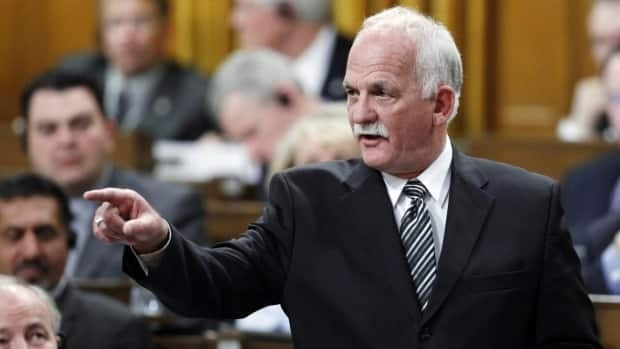 Public Safety Minister Vic Toews faced a fierce online backlash over Bill C-30, which would require internet service providers to turn over client information to law enforcement agencies without a warrant.