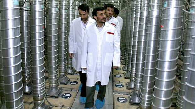 In this April 8, 2008 file photo provided by the Iranian President's Office, Iranian President Mahmoud Ahmadinejad, centre, visits the Natanz Uranium Enrichment Facility some 322 kilometers south of the capital Tehran.