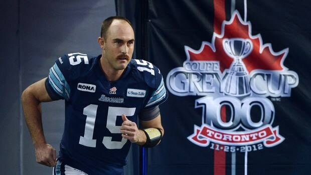 Toronto Argonauts quarterback Ricky Ray runs onto the field before the 100th Grey Cup game against the Calgary Stampeders on Sunday.