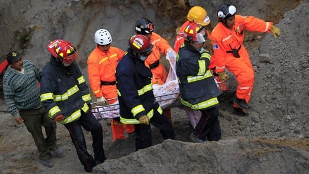 Rescuers carry the body of a man who was killed during a landslide triggered by a 7.4-magnitude earthquake in Guatemala in the San Marcos region, about 250 kilometres south of Guatemala City on Thursday. Wednesday's quake is reportedly the worst to hit the region since 1976.