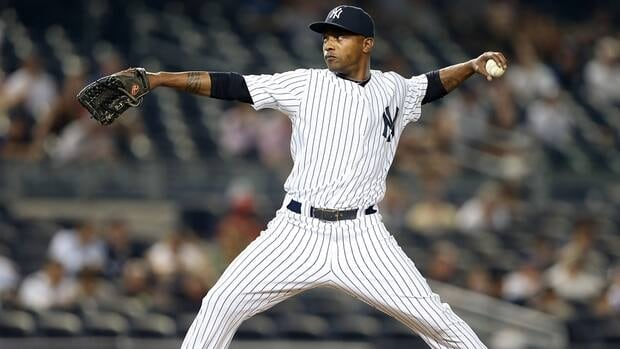 Dewayne Wise of the New York Yankees delivers a pitch against the Chicago White Sox on Friday.