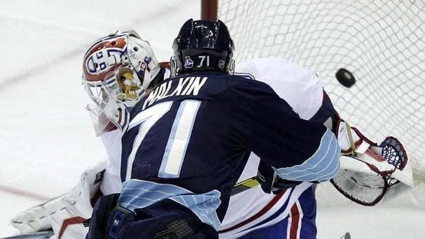 Penguins' Evgeni Malkin scores against Canadiens goalie Peter Budaj during a shootout.
