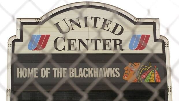 Venue signage is visible through a security fence at the United Center, home of the NHL Chicago Blackhawks hockey team, during the 2004 NHL lockout.
