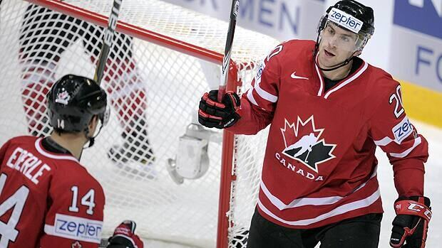 Canada's Jordan Eberle (L) and John Tavares celebrate the team's first goal during the Canada vs Switzerland game of the 2012 IIHF Ice Hockey World Championships.