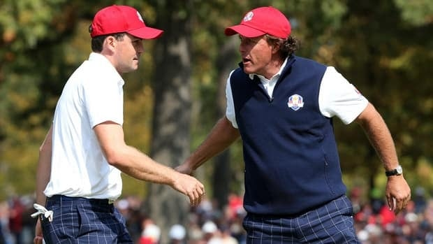 Keegan Bradley, left, and Phil Mickelson of the United States react on the third hole of their afternoon fourball match at the Ryder Cup in Medinah Country Club.