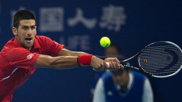 Serbia's Novak Djokovic returns a shot to Michael Berrer of Germany in their men's singles match of the China Open in Beijing on Tuesday.