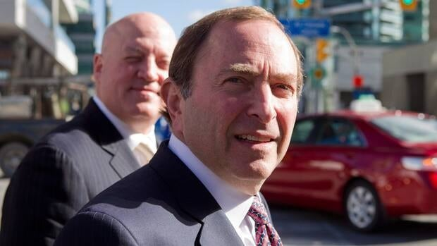 NHL Commissioner Gary Bettman, right, and Bill Daly proposed a deal that includes a 50-50 revenue split with the NHLPA on Tuesday.