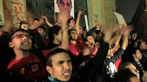 Egyptian fans of Cairo's Al-Ahly soccer club, known as Ultras, protest in front of the office of the prosecutor in central Cairo, after dozens were killed in a stadium riot last month. More violent clashes erupted Saturday after one of the clubs was suspended.