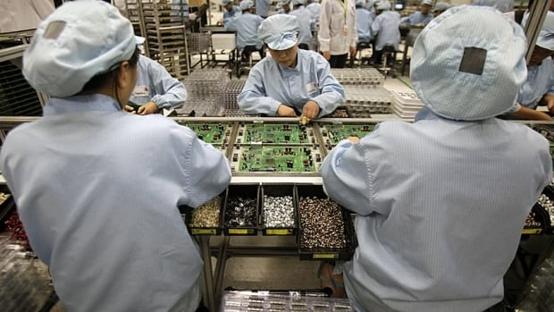 Celestica employees assemble parts on a production line. The company is winding down its manufacturing work with RIM.