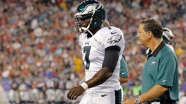 Philadelphia Eagles quarterback Michael Vick leaves the field after taking a hard hit against the New England Patriots on Monday night.