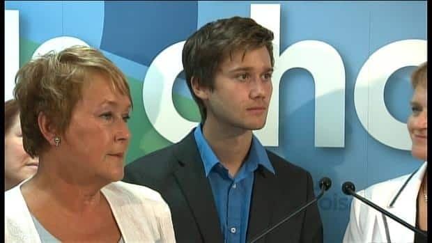 Star Parti Québécois candidate Léo Bureau-Blouin, flanked by leader Pauline Marois, wants a 'peaceful' campaign climate.