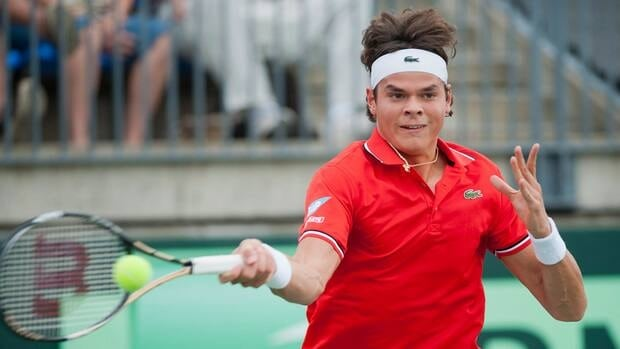 Canada's Milos Raonic returns the ball to Nikala Scholtz of South Africa during Davis Cup tennis action in Montreal, Friday, September 14, 2012.