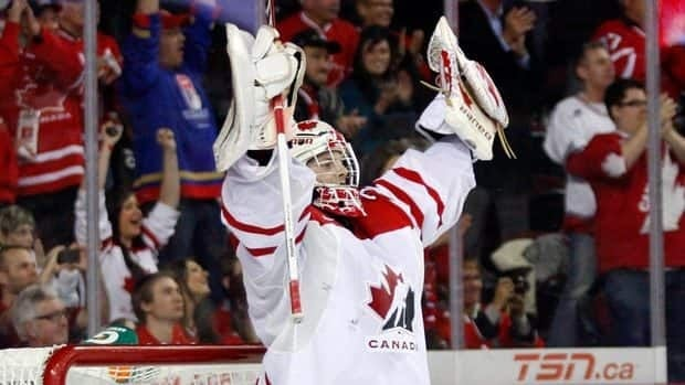 Goalie Mark Visentin celebrates Team Canada's bronze medal win against Finland on Thursday. Visentin turned away 27 shots for the shutout and player of the game honours.