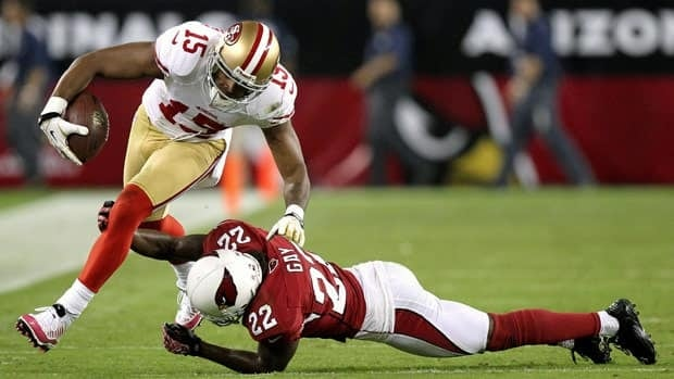 San Francisco 49ers wide receiver Michael Crabtree breaks the tackle of Arizona Cardinals cornerback William Gay during the first half of Monday night's game in Glendale, Ariz.