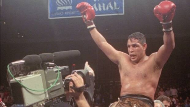 In this file photo from June 22, 1996, Hector Macho Camacho is lifted into the air after his unanimous decision over Roberto Duran in an IBC middleweight title fight at the Trump Taj Mahal Casino Resort in Atlantic City, N.J. Camacho was shot and critically wounded while inside his car on Tuesday. He is expected to be taken off life support on Saturday.
