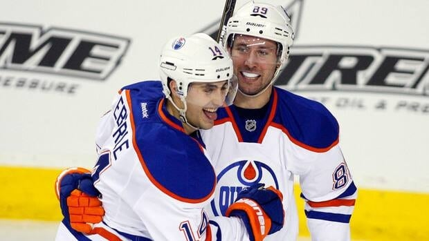 Edmonton Oilers' Jordan Eberle, left, celebrates teammate Sam Gagner's goal during the second period in Calgary on Tuesday.