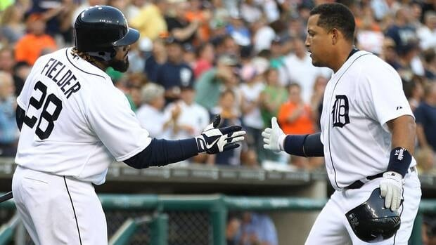 Miguel Cabrera celebrates with teammate Prince Fielder after hitting a solo home run to left field as the Detroit Tigers defeat the New York Yankees on Tuesday night.