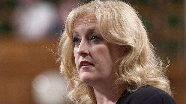 Labour Minister Lisa Raitt shared her experience with postpartum depression at an international conference on mental health and stigma in Ottawa on Monday.