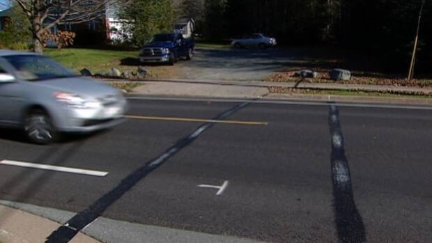 Fresh paint covers a homemade crosswalk in Dartmouth.