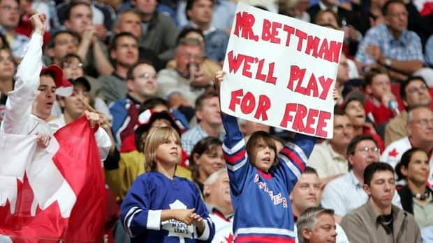 A young fan, shown here in 2004, holds up a sign directed at NHL President Gary Bettman during the 2004-05 lockout.