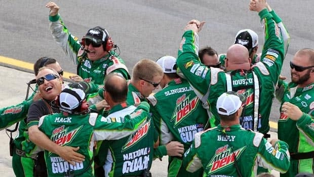 Dale Earnhardt Jr.'s crew members celebrate their win in the NASCAR Sprint Cup Series Quicken Loans 400 auto race at Michigan International Speedway, Sunday, June 17, 2012, in Brooklyn, Mich. (AP Photo/Carlos Osorio)