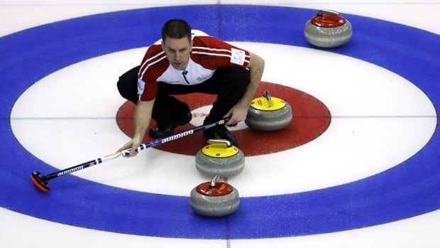 Newfoundland and Labrador skip Brad Gushue lines up a shot during an afternoon draw against Ontario at the Brier on Sunday.