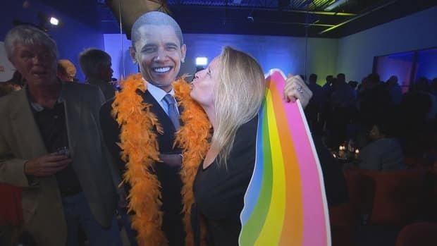 At the Charlotte Unity party during the Democratic National Convention Sept 3-6, members of North Carolina's LGBT community toasted Barack Obama, seen here as a cardboard cutout.